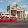 One of Berlin's many tour buses passes the Brandenburg Gate