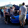 Car lovers, and mechanics gather around a car during car show held at Billy T's Dairy Bar in Bennington on Thursday evening.