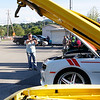 Kathy Williams, of Bennington takes a photo of the classic cars lined up at Billy T's Dairy Bar on Thursday afternoon.
