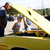 Keagan MacRoberts, 9 years old, of Petersburg NY looks into the hood of a classic car on Thursday evening during the first cruise-in sponsor'd by the Bennington cruizer's and Billy t's Northside Dairy Bar. The event was held at Billy T's Northside Dairy Barn and was free to public. More are encouraged to join during future events.