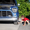 Landon Erickson, 6 years old of Pownal shines the rims of his grandfathers 55 Chevy.