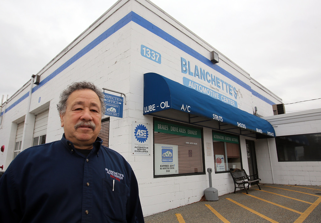 . Rich Blanchette, who is retiring this week after 41 years in business, having sold Blanchette\'s Automotive Service to Pep Boys. He had the blue stripe painted on his building after thinking it needed something extra, and thinks he inspired several other businesses in the area to do stripes, too.  (SUN/Julia Malakie)