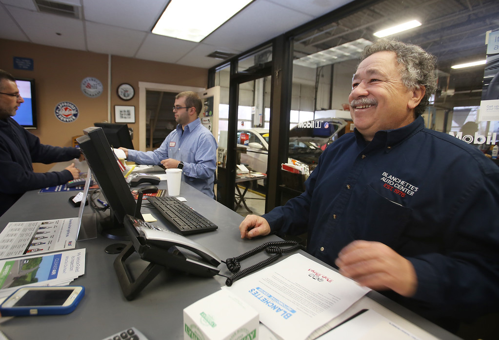 . Rich Blanchette, right, who is retiring this week after 41 years in business, having sold Blanchette\'s Automotive Service to Pep Boys. AJ DaSilva of Tewksbury, center, is one of the full-time employees who will be staying on to work for Pep Boys. (SUN/Julia Malakie)