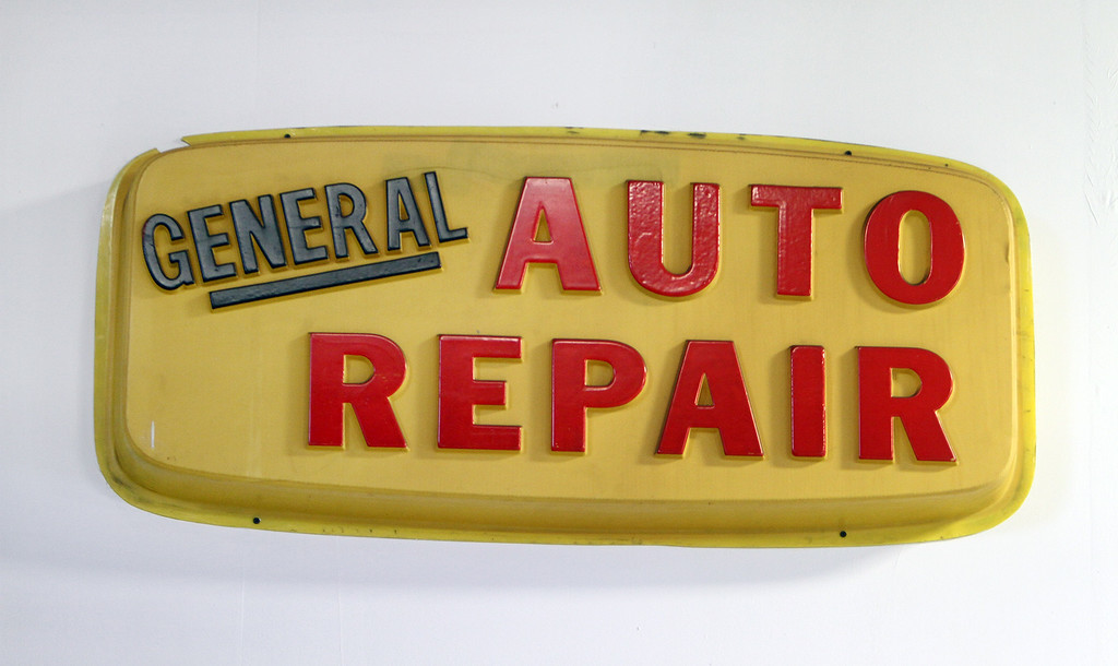 . One of the old signs on the wall in the workshop at Blanchette\'s. Rich Blanchette, who is retiring this week after 41 years in business, having sold Blanchette\'s Automotive Service to Pep Boys.  (SUN/Julia Malakie)