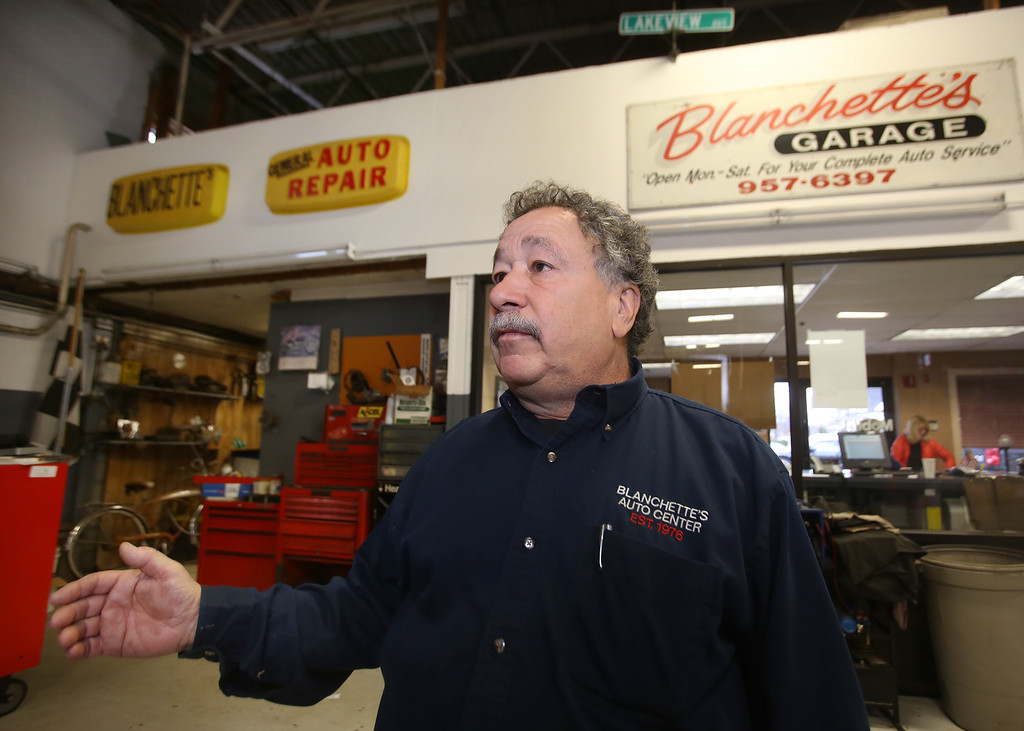 . Rich Blanchette, who is retiring this week after 41 years in business, having sold Blanchette\'s Automotive Service to Pep Boys. Some of his old signs are up on the wall. (SUN/Julia Malakie)