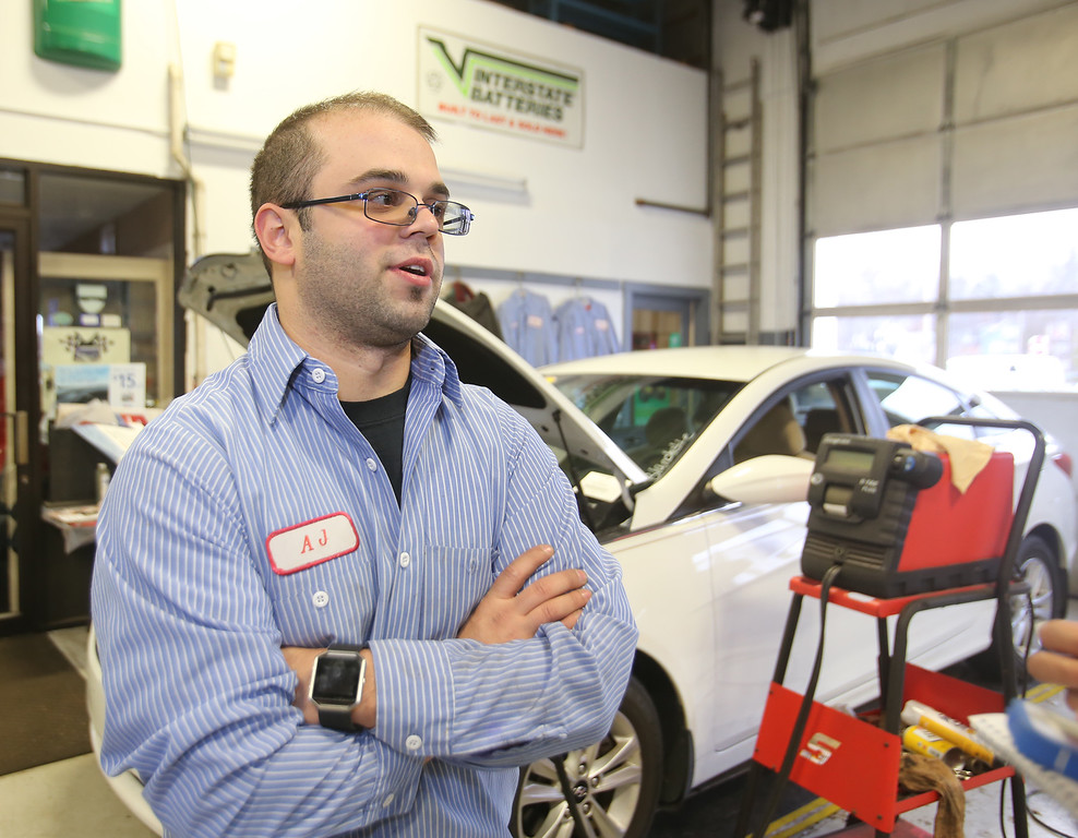 . AJ DaSilva of Tewksbury, who\'s been working at Blanchette\'s since he was a co-op at Greater Lowell Tech, is one of the full time employees who will be staying on. Owner Rich Blanchette is retiring this week after 41 years in business, having sold Blanchette\'s Automotive Service to Pep Boys.  (SUN/Julia Malakie)