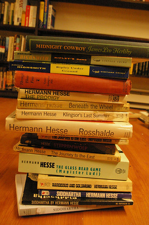 A big stack of Herman Hesse books awaiting shelving.