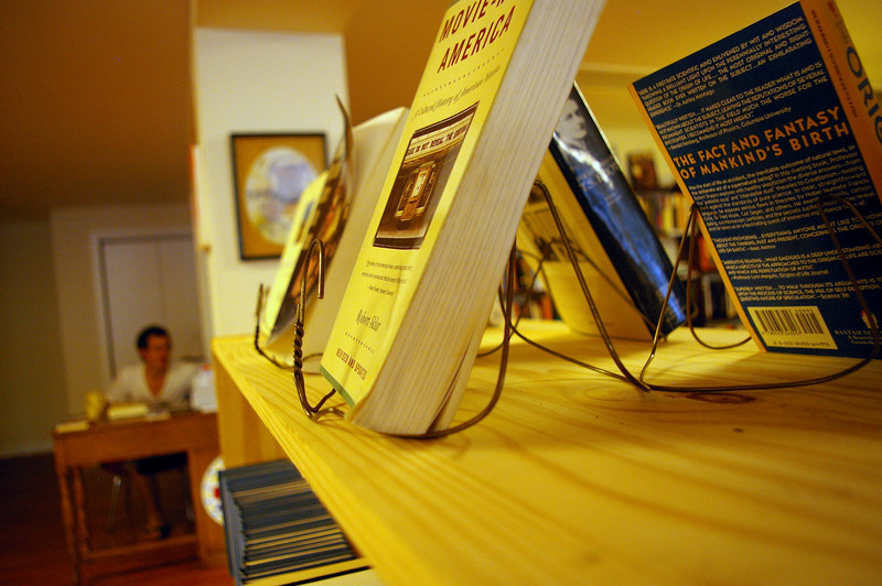 Wire coat hanger book stands by Jason Page
