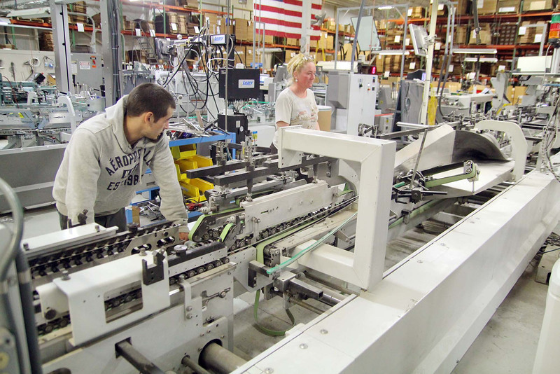 Boutwell Owens has machines that fold all the boxes they print to make it fast. Setting up a folding order is Jeff Moran and Supervisor Nikole Ferlong on the Bobst Alpine Machine.  SENTINEL & ENTERPRISE/JOHN LOVE