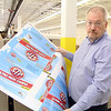 Boutwell Owens Vice President of Sales & Marketing William Hodges shows off the packaging for STP that they recently printed at their company in Fitchburg. SENTINEL & ENTERPRISE/JOHN LOVE