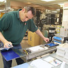 Boutwell Owens inkroom manager Eric Sanford is creating a customer prototype on Monday at the facility in Fitchburg.  SENTINEL & ENTERPRISE/JOHN LOVE