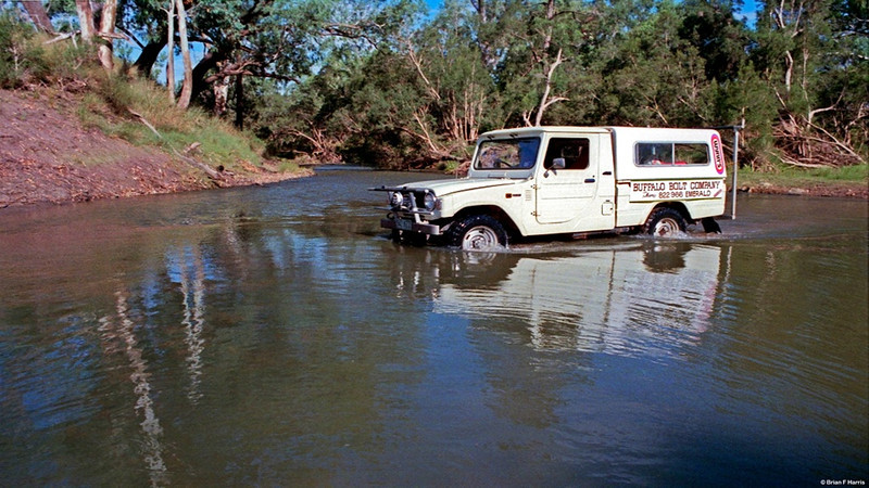 Our mighty Diahatsu 2.4Ltr diesel 4x4 (real 4x4 with FWH and solid axles front & rear) crossing Nagoa River just downstream of the old weir at Emerald, Qld. Thanks desk jockeys, all this is fenced off.