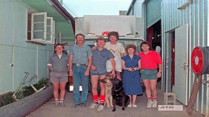 Our Buffalo crew in Church Lane store. L-R Geoff, Brian (with mou), Craig, Barbara, Annette, Adrain (Ace) and our Kimber dog. To the right is our big new shed we got built. Years later the fibro house was sold for removal. Behind is our Ford Trader (Mazda) light truck (cab over) with air foil.