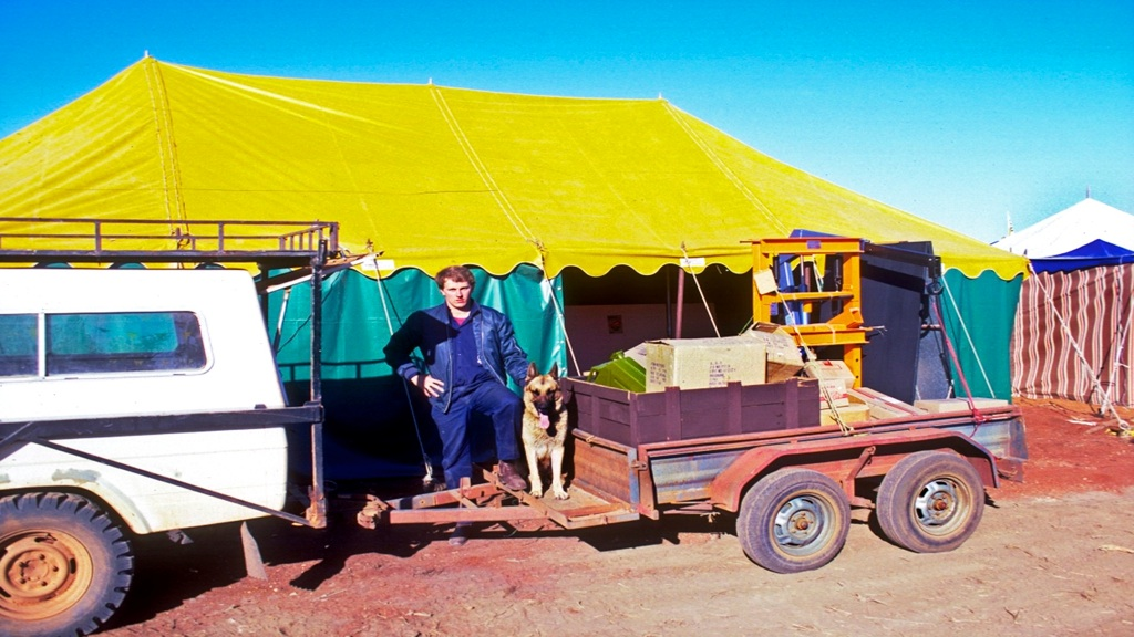 Craig with the Shepherd he was given as a pup. Unloading our stock for AG-Grow display into the tent we had hired.
