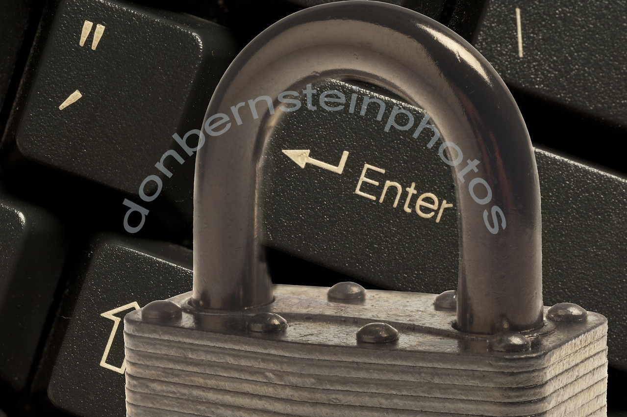 Padlock combined with computer keyboard is a metaphor/symbol for cyber/computer technology security strategy... finding a way to counter this growing threat to business and all government.
