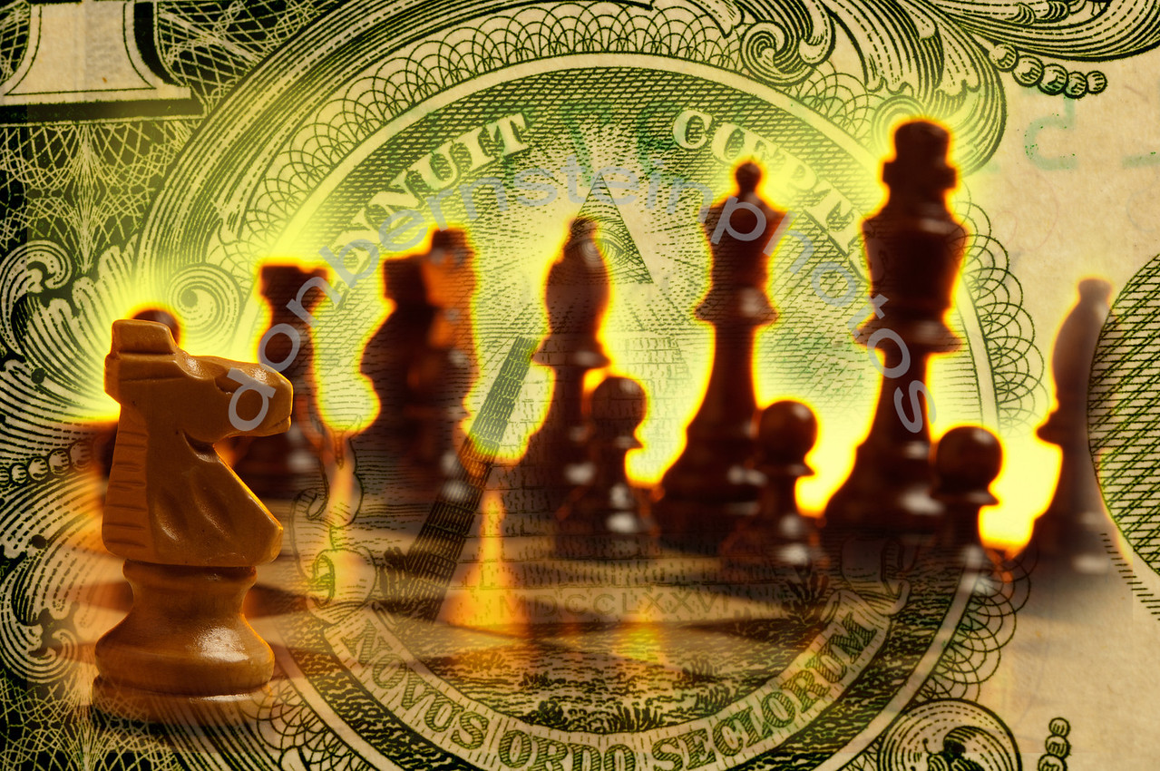 Chess pieces on board combined with imagery from U.S. currency is a metaphor/symbol for financial strategy and money management.