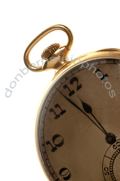 Antique pocket watch with hands pointing to two minutes before 12:00 is a metaphor/symbol for running out of time, deadline approaching.