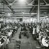 Plastics finishing room, view down center aisle, General Electric plastics department, I Plastics Ave., Pittsfield, Mass.  February 17, 1938. General Electric Photo