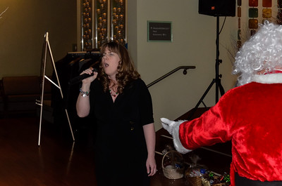 "Civil & Technical Support Manager Marissa G sings to CEO Jeff ""Santa"" Gravatte"