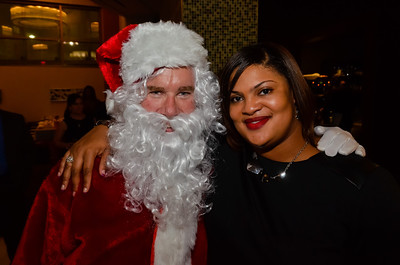 "CEO Jeff ""Santa"" Gravatte with Training Program Manager Nakeisha L"