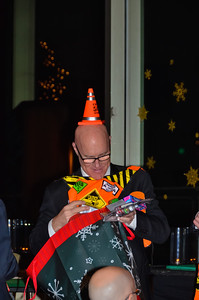 "Jeff ""the conehead"" Gravatte opening his gifts"
