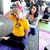 "White Wave Perks9.JPG Megan Rehm, left, gets an adjustment from yoga instructor, Rose Ode, during the Wednesday class.<br /> One of the White Wave Company perks is a free weekly yoga class at the Broomfield facility.<br /> For a video of the class, go to  <a href=""http://www.dailycamera.com"">http://www.dailycamera.com</a>.<br /> Cliff Grassmick / February 9, 2012"