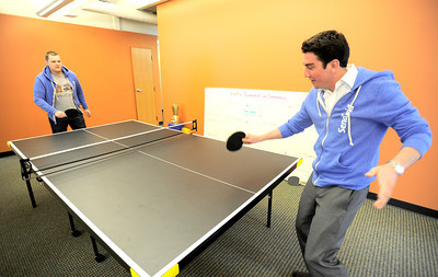 0207PERKS3.jpg Grant Holl (right) and Rob Piers (left) take a break to play some ping pong at SendGrid in Boulder, Colorado February 7, 2012. SendGrid offers employee perks such as a small refrigerator with different beers, cookie Tuesday and ping pong. CAMERA/MARK LEFFINGWELL