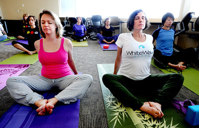 White Wave Perks1.JPG Tammy Bieber, left, and Caroline Mergatroyd, participate in the Wednesday yoga class at White Wave. One of the White Wave Company perks is a free weekly yoga class at the Broomfield facility. For a video of the class, go to www.dailycamera.com. Cliff Grassmick / February 9, 2012