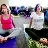 "White Wave Perks1.JPG Tammy Bieber, left, and Caroline Mergatroyd, participate in the Wednesday yoga class at White Wave.<br /> One of the White Wave Company perks is a free weekly yoga class at the Broomfield facility.<br /> For a video of the class, go to  <a href=""http://www.dailycamera.com"">http://www.dailycamera.com</a>.<br /> Cliff Grassmick / February 9, 2012"