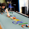 "Google Building002.JPG Program Manager Jordan Van Wyk plays a game of pool in the Google break room on Tuesday, Feb. 7, at the Google building on Pearl Street in Boulder. For a video about the Google workplace environment go to  <a href=""http://www.dailycamera.com"">http://www.dailycamera.com</a><br /> Jeremy Papasso/ Camera"