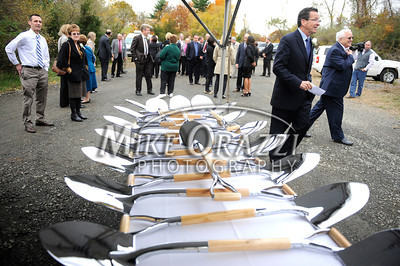 10/24/2012 Mike Orazzi | Staff Gov. Dannel P. Malloy walks past an array of shovels at the groundbreaking ceremony for the Hospital of Central Connecticut's new Cancer Center on the New Britain and Plainville line on Wednesday afternoon.