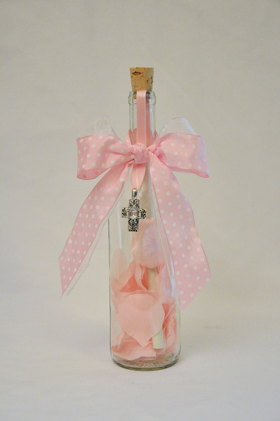 "Easter Bottle - Share a permanent Easter memory with someone close to you with this exquisite Happy Easter bottle. This 12"" Bordeaux bottle is filled with Easter cheer and pastel silk rose petals.. This fun and memorable message in a bottle is sealed with your personalized message scroll and topped off with a pastel ribbon and bow and beautiful cross charm."