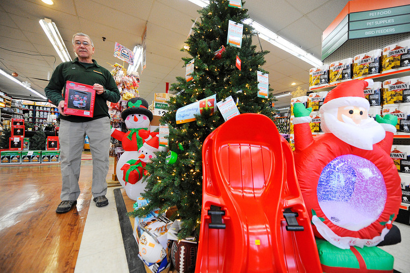 Manager Tom St. Pierre stands with inflatable Christmas decorations at the Aubuchon Hardware store in Parkhill Plaza in Fitchburg, Tuesday.<br /> SENTINEL & ENTERPRISE / BRETT CRAWFORD