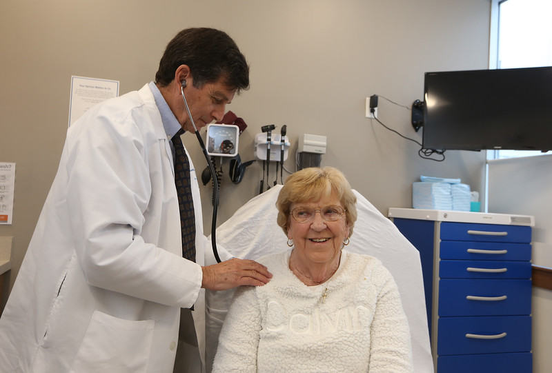 Circle Heath urgent care centers, including this one in Dracut, are an alternative to going to the emergency room. Dr. Peter Sarafan, M.D., of Acton, examines Joanne Deschenes of Tyngsboro. (SUN/Julia Malakie)