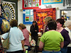 Wearing a black shirt, Kay Geise is our Long arm machine quilter.