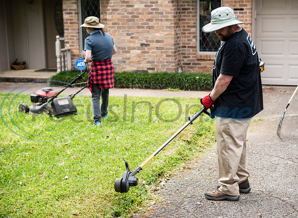 """Clay Riggs uses an edger on a lawn in Tyler on Wednesday, April 1, 2020. Riggs, owner of Clay's Cuts, and a barber for 16 years, switched to a lawn mowing service as businesses were being closed due to the coronavirus. Gov. Greg Abbott ordered all non-essential business in Texas to close, including barber shops and hair salons. On March 30, the Clay's Cuts Facebook page announced: """"Clay's Cuts lawn service is go! Covid-19 has closed the shop, but I can clean your yard without getting too close to you. If you need some yard work done, please call 9038059566. Raking, mowing, weed-whacking and more! Liz and I are happy to help! Thanks for your support!"""""""