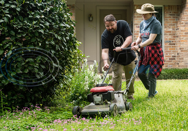 Barber changes from cutting hair to cutting grass