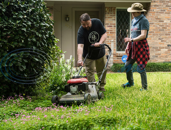 """Clay Riggs teaches his fiancé Liz Cace to mow lawns with him while doing lawn care at his aunt's house in Tyler, Texas on Wednesday, April 1, 2020. Riggs, owner of Clay's Cuts, and a barber for 16 years, switched to a lawn mowing service as businesses were being closed due to the coronavirus. Gov. Greg Abbott ordered all non-essential business in Texas to close, including barber shops and hair salons. On March 30, the Clay's Cuts Facebook page announced: """"Clay's Cuts lawn service is go! Covid-19 has closed the shop, but I can clean your yard without getting too close to you. If you need some yard work done, please call 9038059566. Raking, mowing, weed-whacking and more! Liz and I are happy to help! Thanks for your support!"""""""