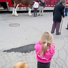 One of the famed Budweiser Clydsdale horses made an appearance at Wyman's Liquor's on Wednesday around noon. Getting a nice picture of the horse is Chole Hebert, 4, from Leominster with her dog Brandon. SENTINEL & ENTERPRISE/JOHN LOVE