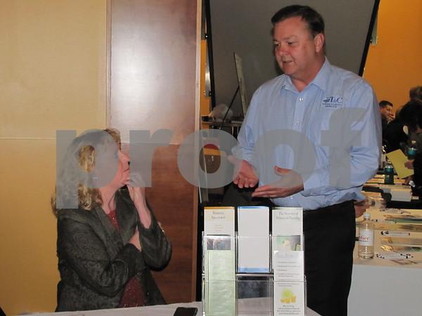 Peggy Trevino of Trevino Associates, P.C. talks with insurance man Bennett O'Connor.