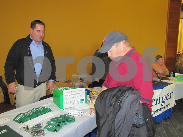 Mark Babbitt looks over some information from Heartland Bank while attending the Entrepreneur Expo at ICCC.