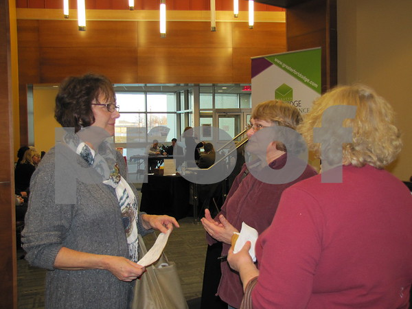Susan Bush visits with Terry Sponheimer after a session at the Entrepreneur Expo on the campus of ICCC.