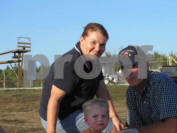 Robin and Dewayne Newell with their grandson Mason.