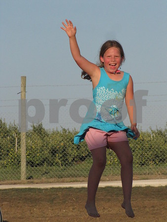 Kaylene Klein shows how much fun it is to jump at the 'Pillow Jump' at the Back 40 at the Community Orchard.