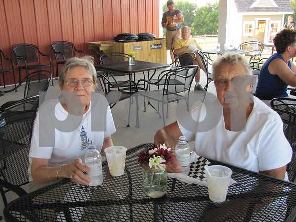 Garnita Johnson and Donna Rae Porter enjoy sundaes in the shade.