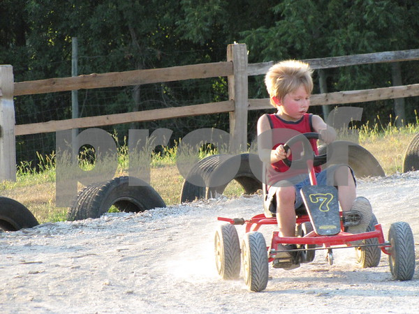 Kaleb Klein takes a spin around the go-cart track at the 'Back 40'.
