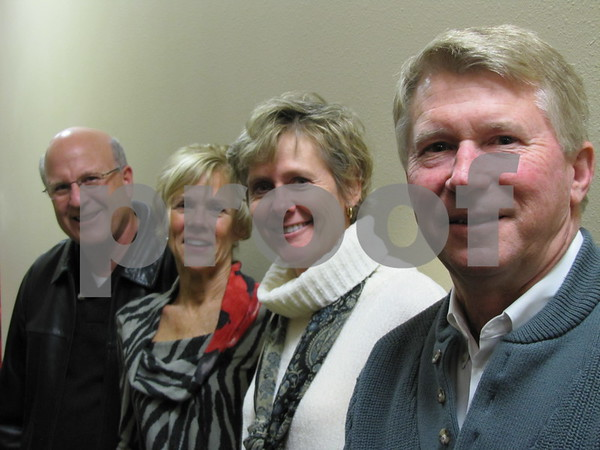 Nick and Pam Drzycimski, and Gloria and Doug Harrell attended the holiday open house for Northwest Bank.