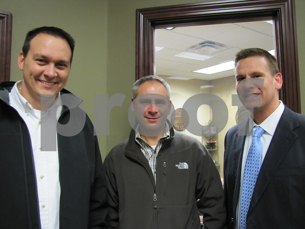 Bill Shimkat, Mike Huss, and Brian Erickson, EVP of Northwest Bank, at the holiday open house.