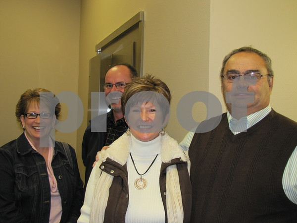 Jackie Keigher, Steve, and Linda and Keith Dencklau at Northwest Bank's holiday open house.