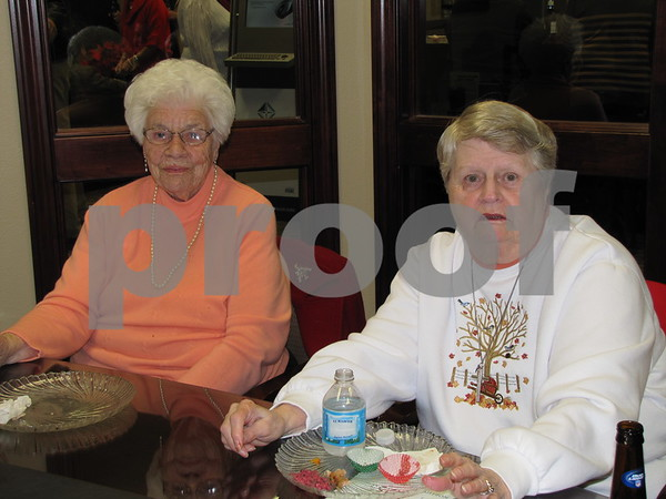 Joanne Jenkins and Ann Larson at Northwest Bank's holiday open house.